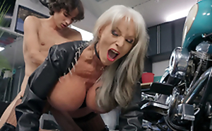 Sally D'Angelo gets pounded by juvenile Ricky Spanish next to her Harley